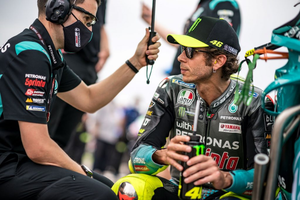 MotoGP racer Valentino Rossi speaks with his Petronas mechanic at the 2021 German Grand Prix