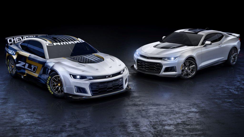 The silver-black-and-gold NASCAR Next Gen Chevrolet Camaro ZL1 next to a silver road-going 2021 Chevrolet Camaro ZL1