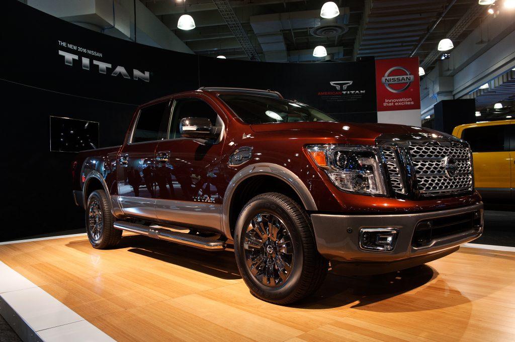 A maroon Nissan Titan pickup truck