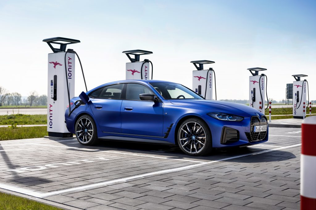 A BMW i4 M50 plugged in at an EV charger