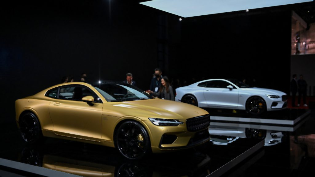 A gold Polestar 1 next to a White Polestar 1 at the 19th Shanghai International Automobile Industry Exhibition in Shanghai.