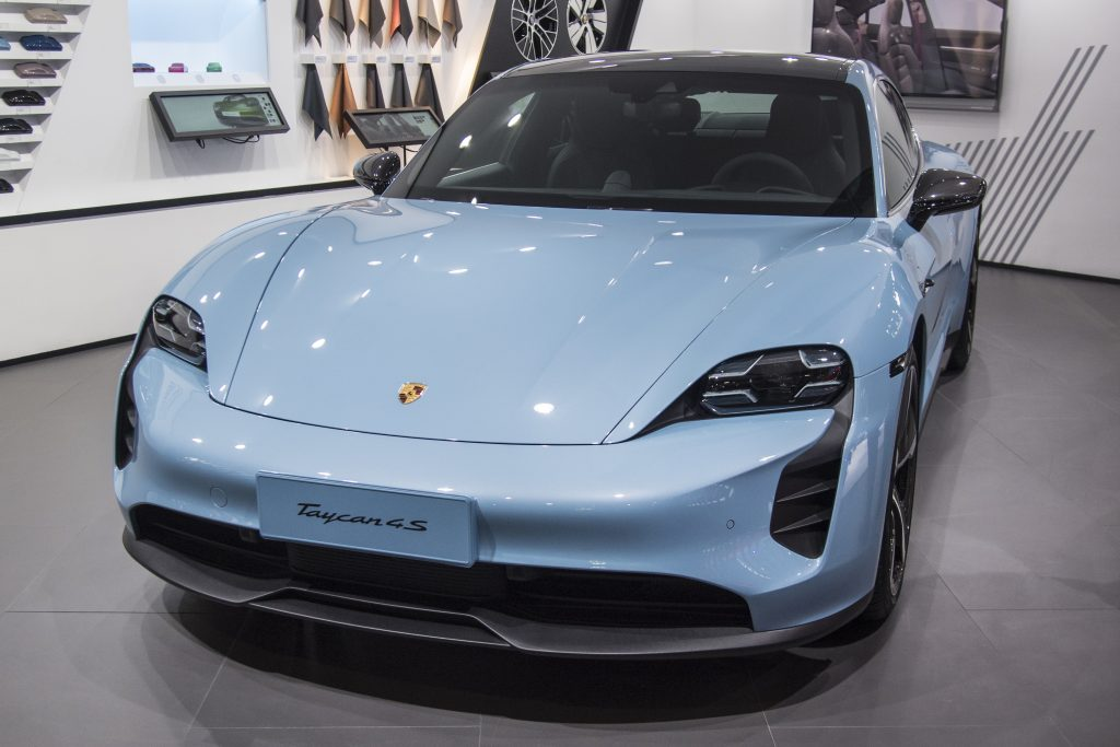 A blue Porsche Taycan 4S vehicle is on display during the 18th Guangzhou International Automobile Exhibition at China Import and Export Fair Complex