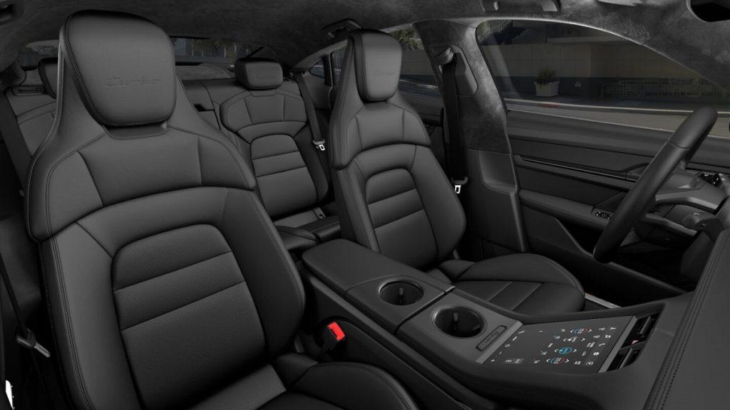 The black interior of a 2021 Porsche Taycan.
