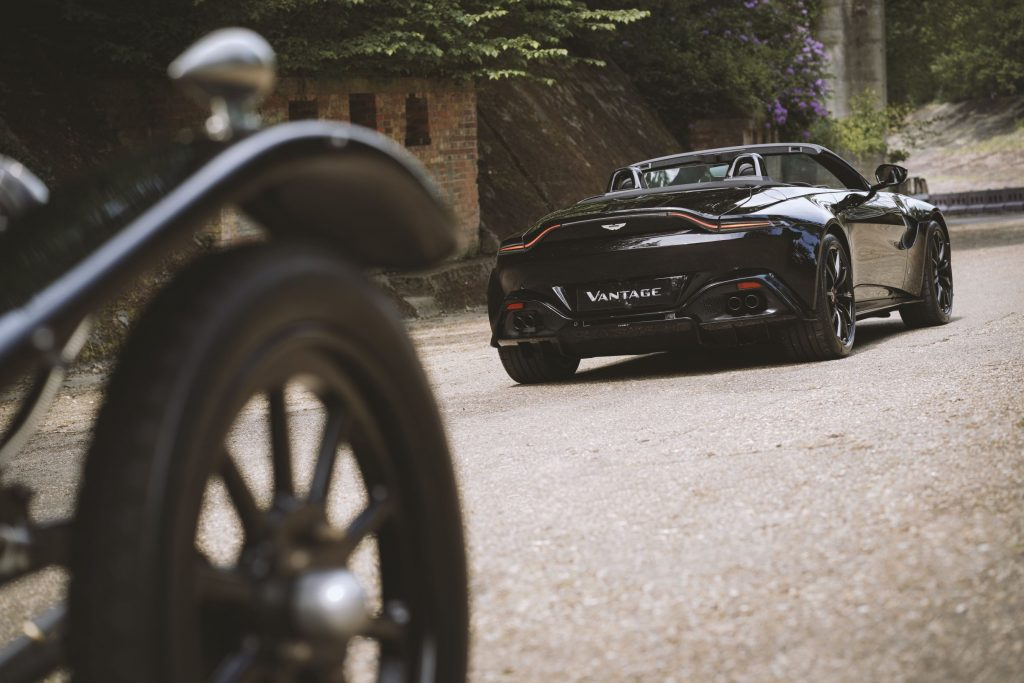 The rear 3/4 view of the black A3-inspired Q by Aston Martin Vantage Roadster rear 3/4 with the 1921 Aston Martin A3 in the foreground