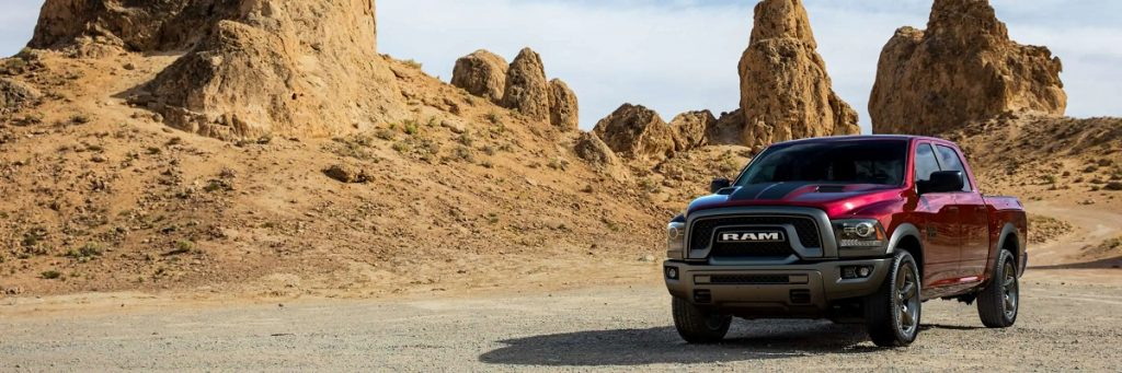 A maroon 2021 Ram 1500 classic in the desert.