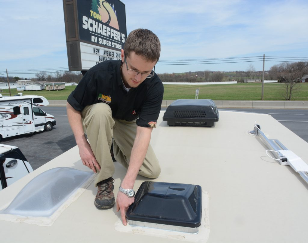 Checking RV Maintenance at Tom Schaeffer's RV Super Store, in Shoemakersville, with Aaron Bashore, service advisor. Check seals on roof vents and sky lights.