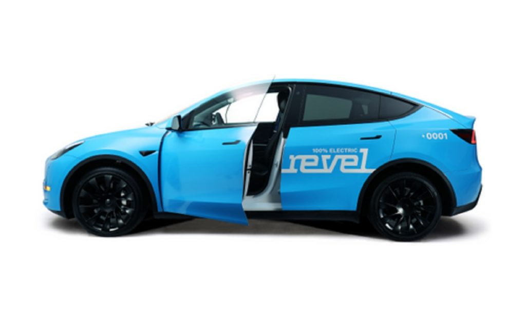 """A blue Tesla Model Y with """"revel"""" printed on the side."""