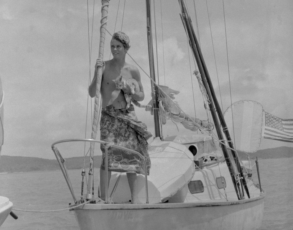 Robin Lee Graham, 18, holds his ginger tabby cat, Avanga, aboard his 24-foot sloop in 1967