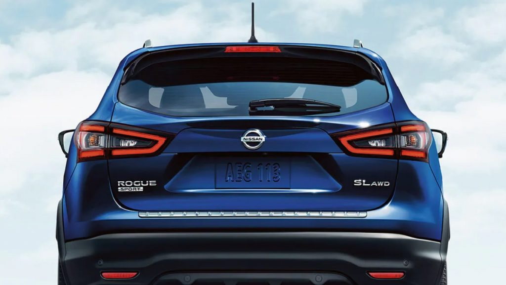 The rear of a blue 2021 Nissan Rogue Sport.