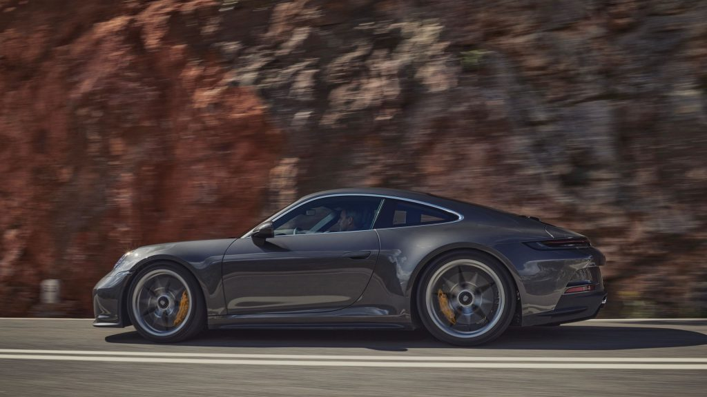 A grey Porsche 911 GT3 hightails it down a canyon road