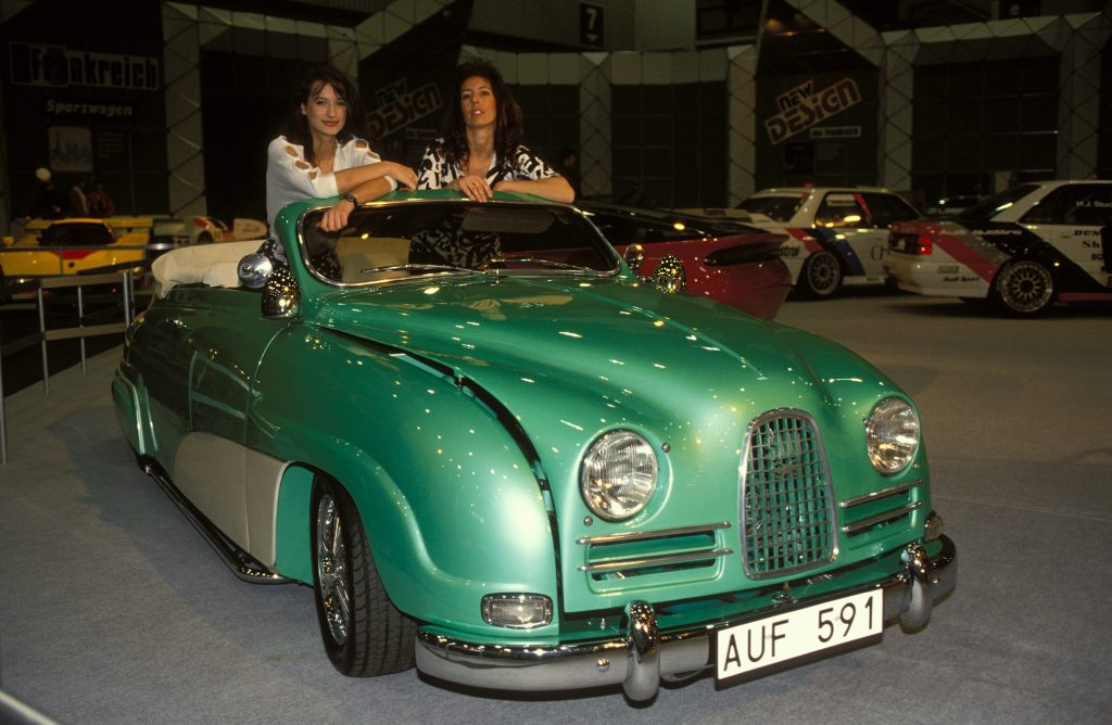 old green Saab with two women