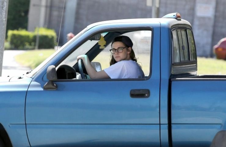 a blue single cab Toyota T100 with Kristen Stewart in the drivers seat