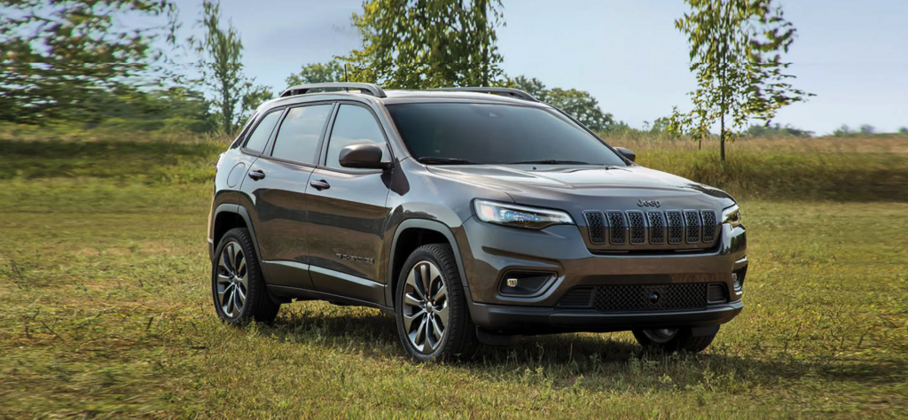 The 2021 Jeep Cherokee parked in grass