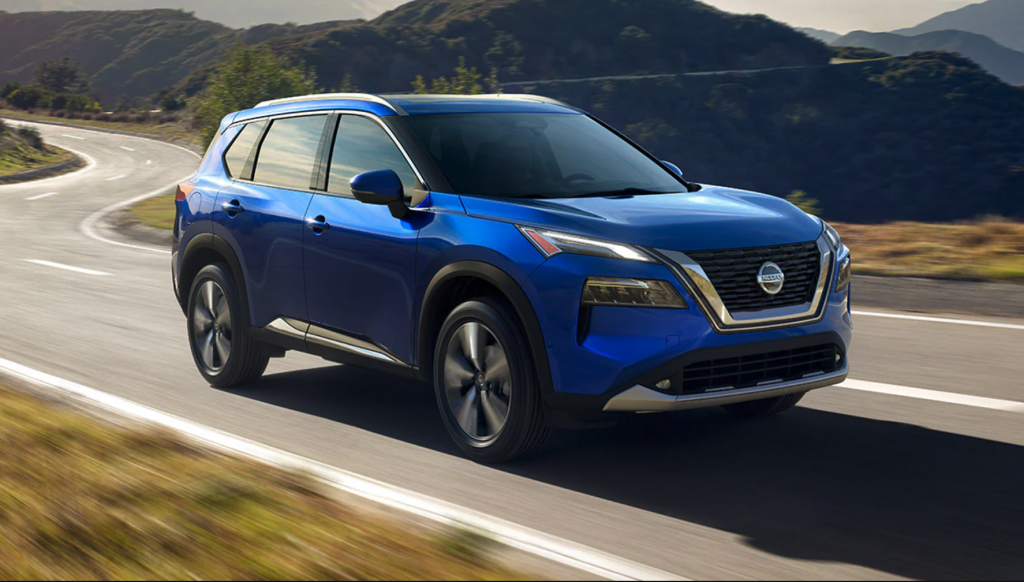 A 2020 Nissan Rogue driving down the road