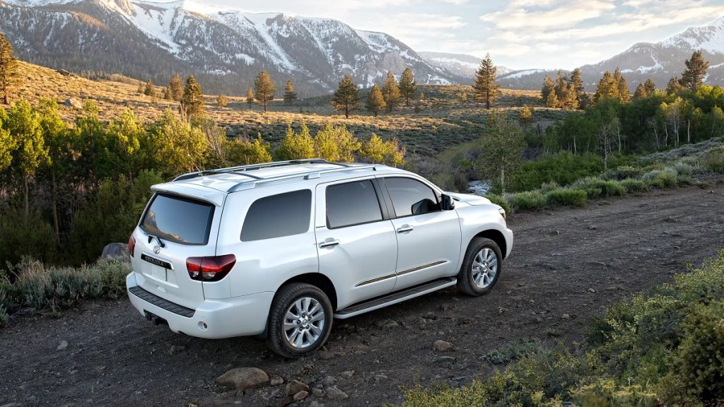 A white 2021 Toyota Sequoia drives up a mountain.