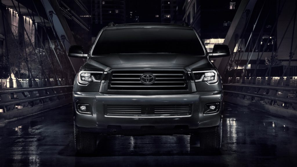 A black 2021 Toyota Sequoia against a black background.