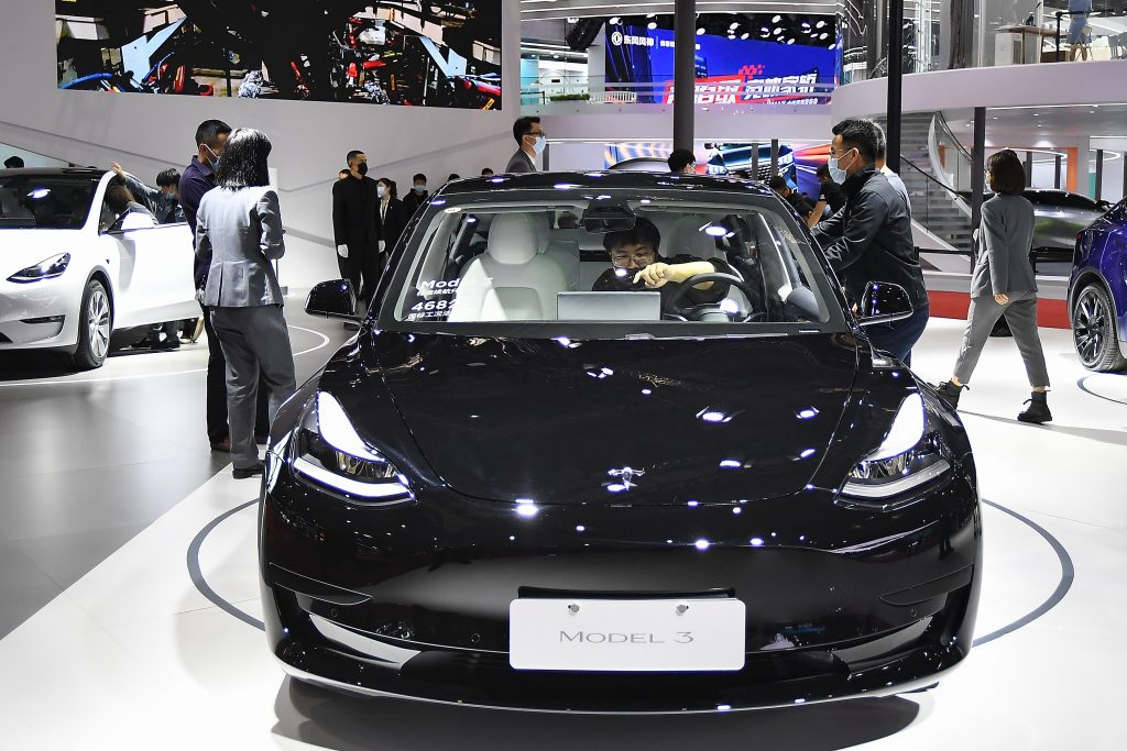 A black Tesla Model 3 car is on displayed during the 19th Shanghai International Automobile Industry Exhibition