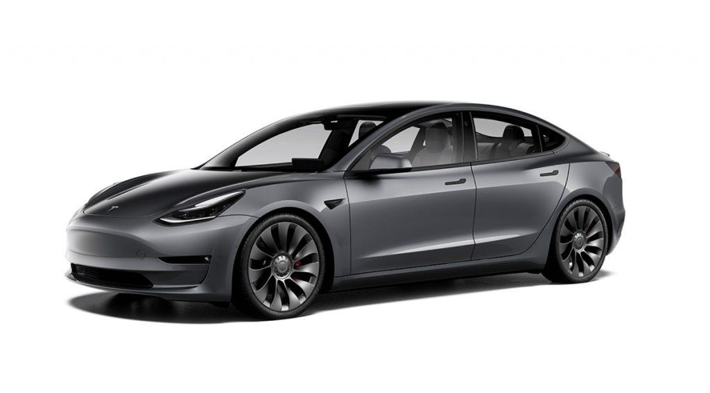 A dark gray Tesla model 3 against a white background.