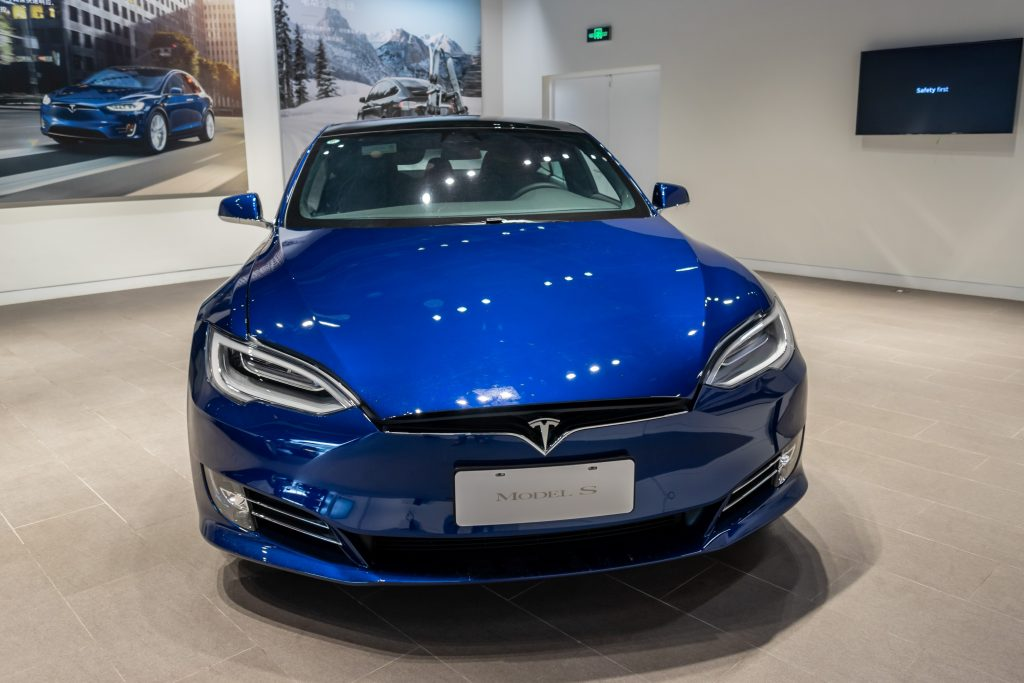 Blue Tesla Model S in the exhibition hall of the newly opened Tesla experience center. Shanghai, China