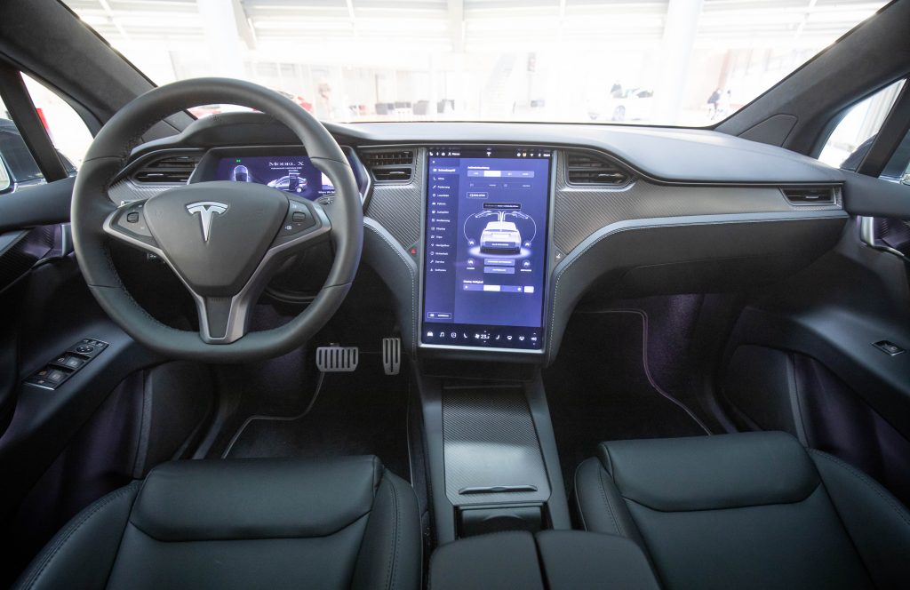 View into the interior with steering wheel and display of a Tesla Model X in the new Tesla Service Center
