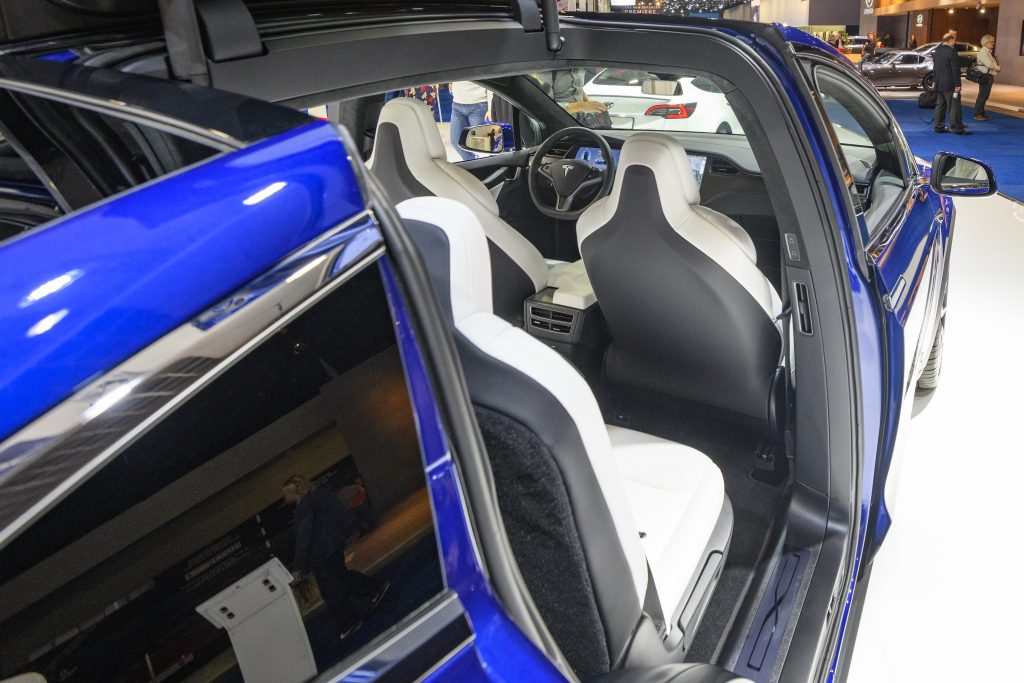 Open Falcon wing doors on a Tesla Model X 90D full electric luxury crossover SUV car on display at Brussels Expo
