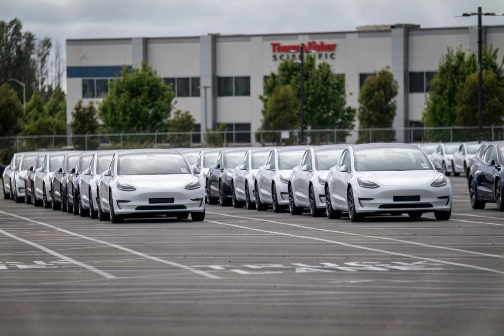 Tesla cars lined at the factory for deliveries