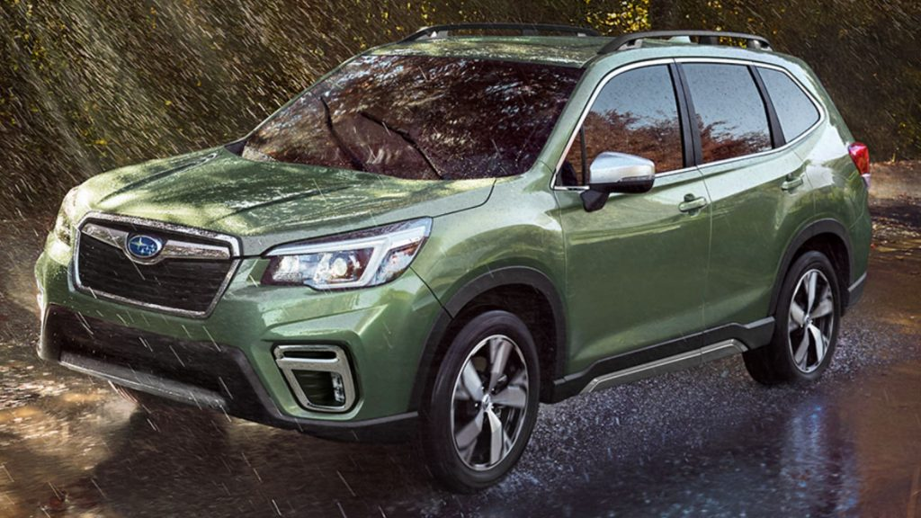 A Green 2021 Subaru Forester driving in the rain.