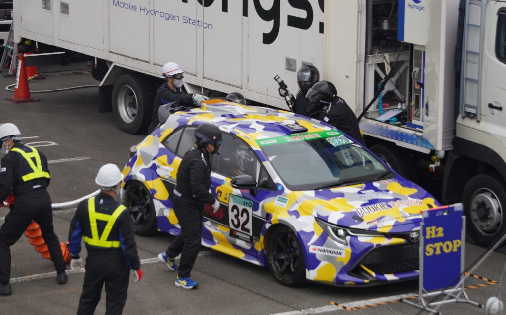 Toyota Corolla hydrogen-powered race car in the pits