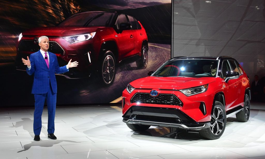 Toyota North America's Jack Hollis, group Vice president and general manager, introduces the red 2021 Toyota RAV4 Prime at the 2019 Los Angeles Auto Show
