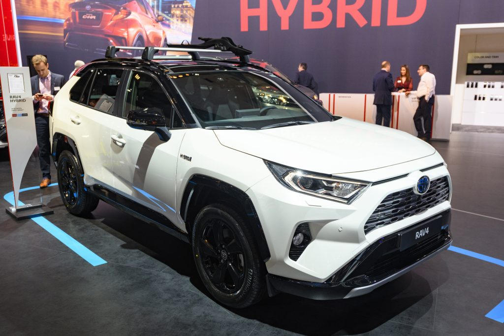 White Toyota RAV4 Hybrid compact SUV on display at Brussels Expo