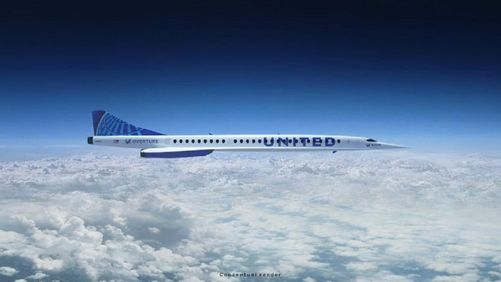 """A white plane with a blue """"United"""" printed on the side, flying high above the clouds."""