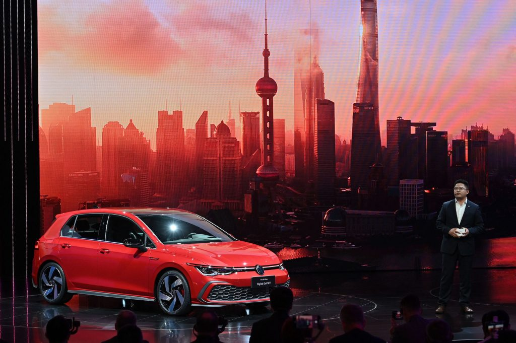 Guo Yongfeng, President of Faw-Volkswagen Sales, presents the new red Volkswagen Golf GTI car during the 19th Shanghai International Automobile Industry Exhibition