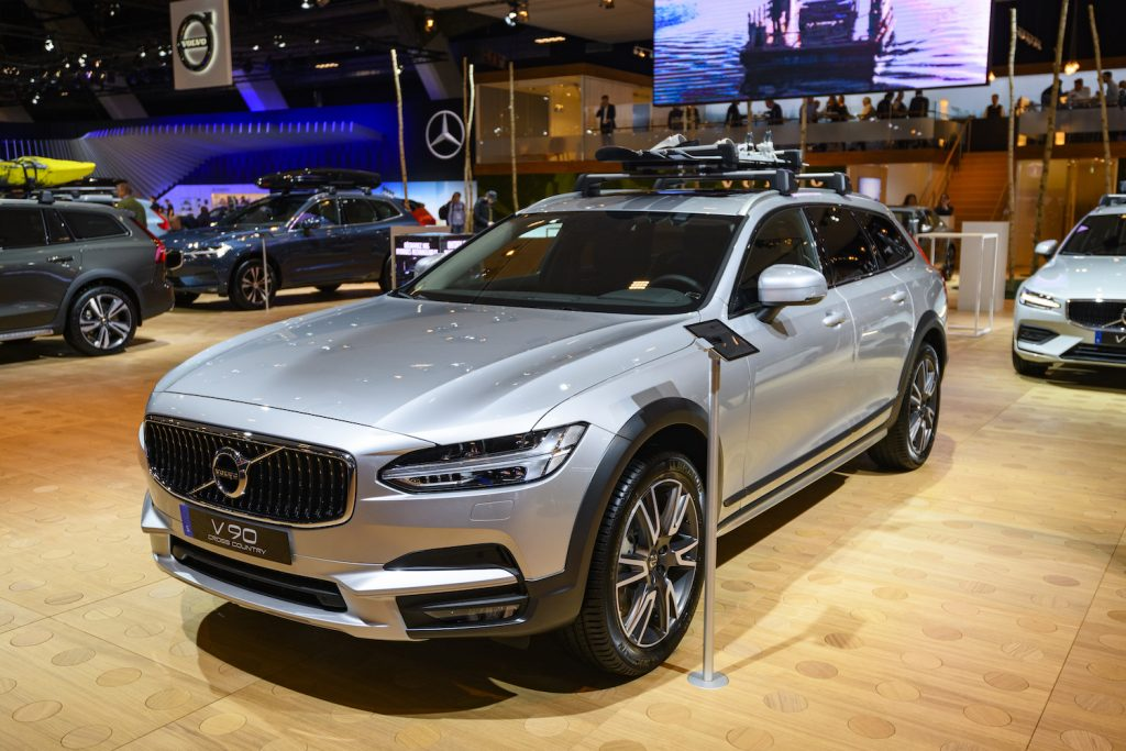 A silver Volvo V90 Cross Country at an auto show, the V90 Cross Country is one of the best luxury cars for tall drivers
