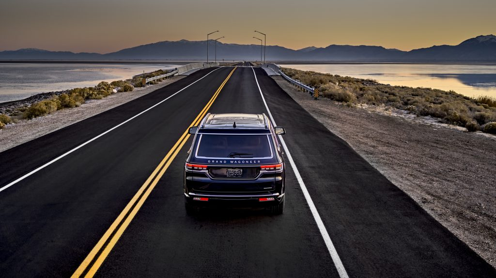 The 2022 Jeep Grand Wagoneer drives off into the sunset