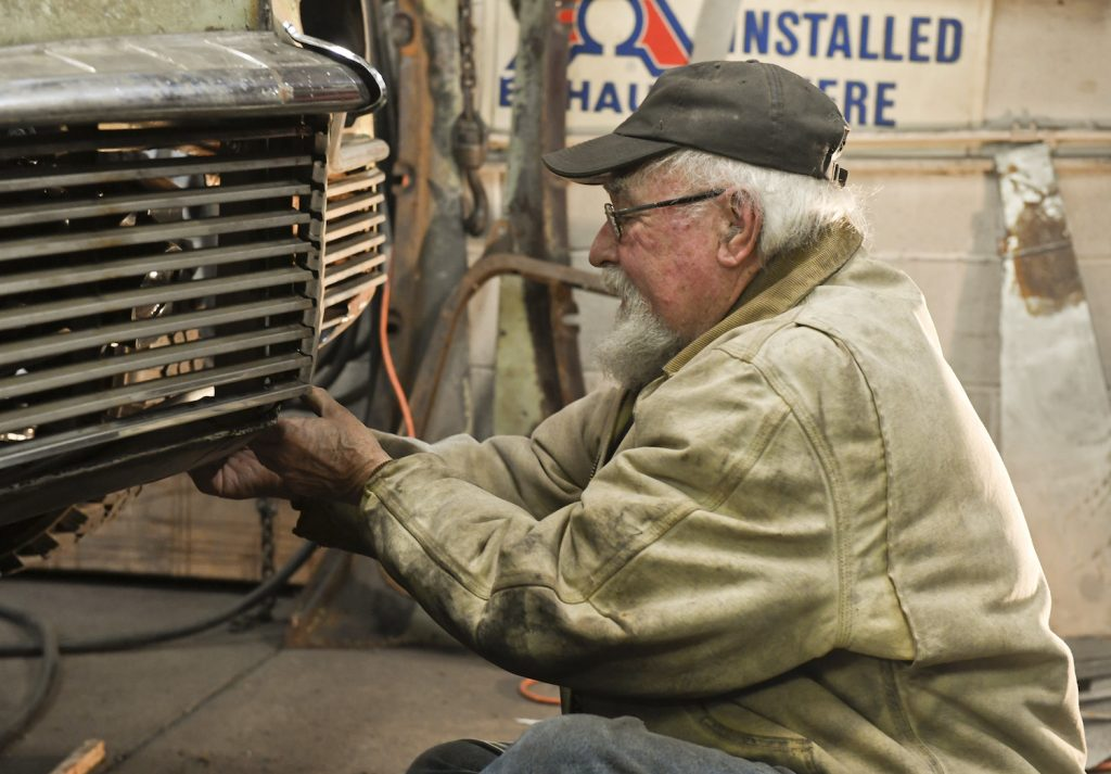 A mechanic working on a classic car. If you're selling a classic car, you'll need records from your mechanic.