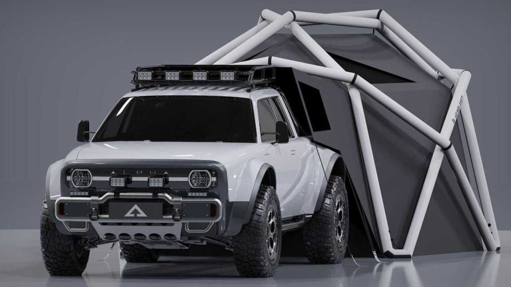A white Alpha Wolf+ Cloudbreak electric pickup truck with a geodesic tent
