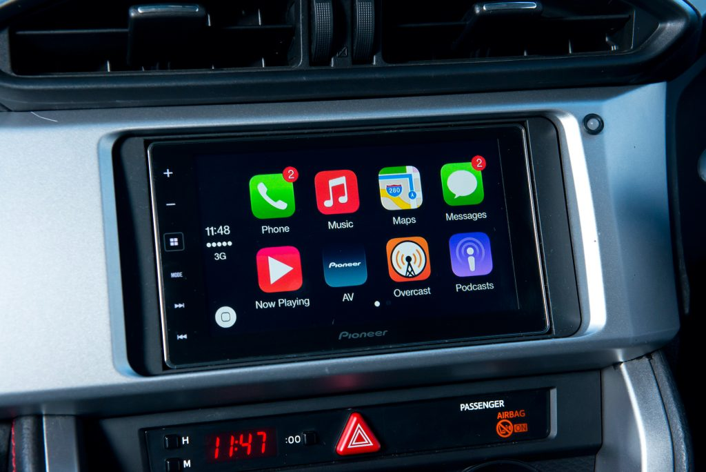 Detail of a Pioneer head unit fitted in a Subaru BRZ, photographed for a feature on Apple's CarPlay.