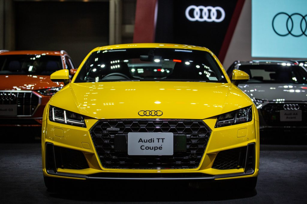A bright yellow audi tt coupe