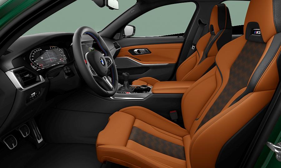 The Kyalami Orange interior of the M3 with manual transmission
