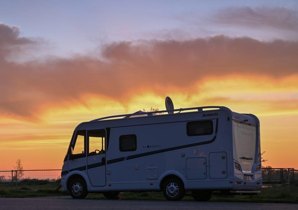 A camper van at sunrise