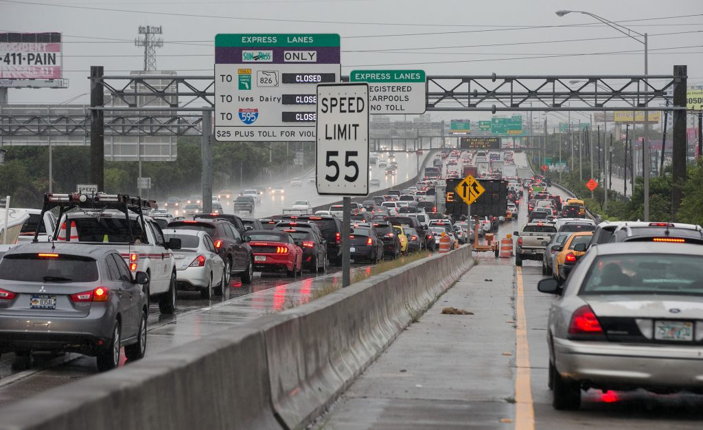 Vehicles with hazard lights on in bumper-to-bumper traffic on Interstate 95 northbound in Miami in September 2018