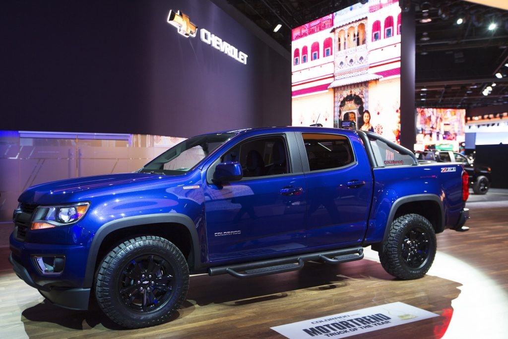 A blue Chevy Colorado pickup truck on display