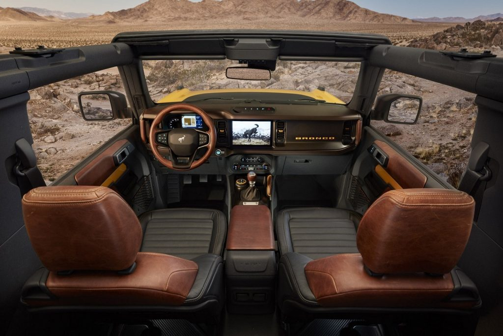 The Bronco interior with no roof or doors and a manual transmission