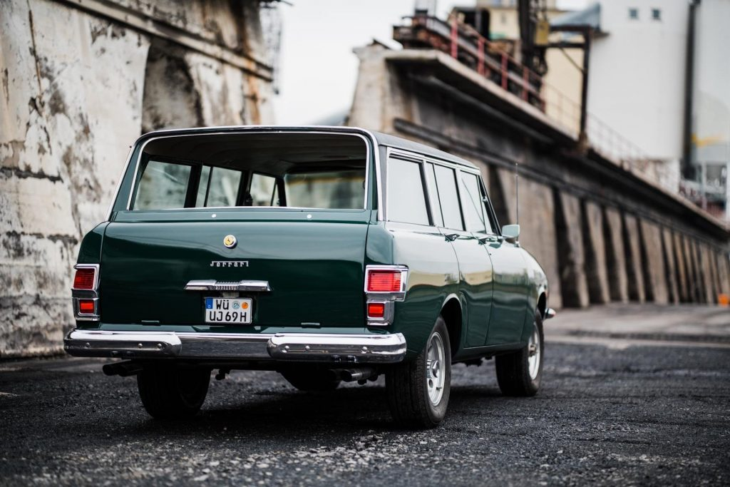 """An image of a Jeep Grand Wagoneer with a Ferrari face called the """"Jerrari"""" parked outdoors."""