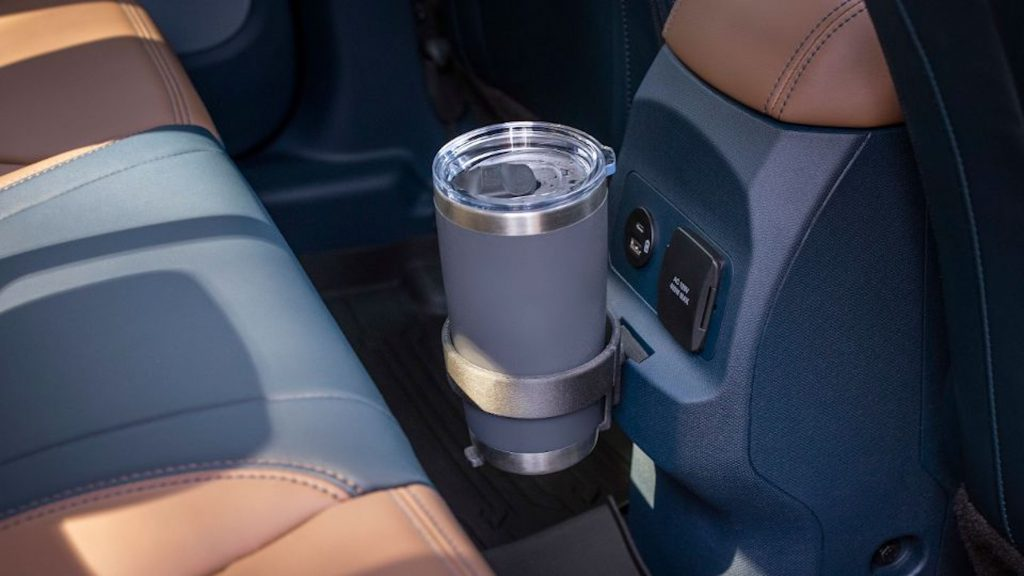A cup holder attached to the FITS system in A Ford Maverick