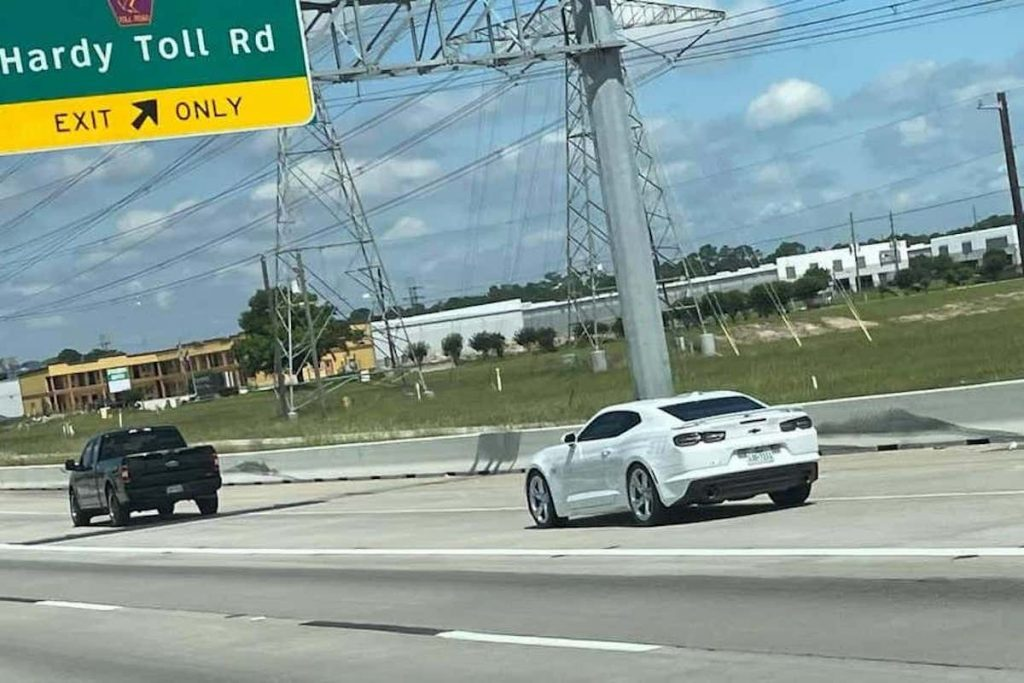 Texas police Camaro following a car on the highway