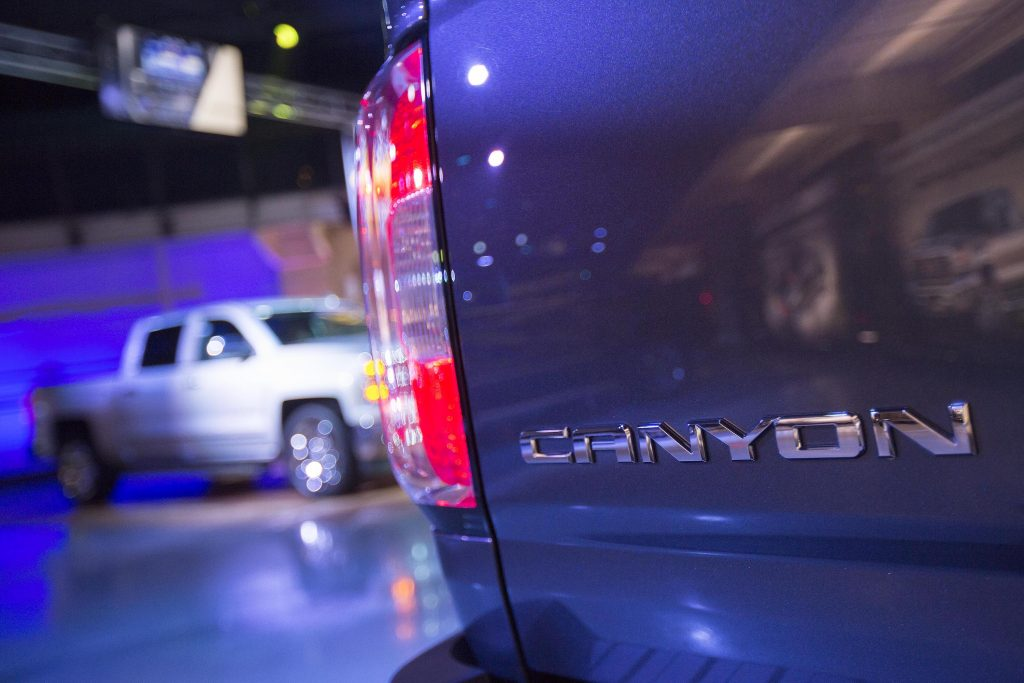 The Canyon badge of a 2015 GMC Canyon pickup truck
