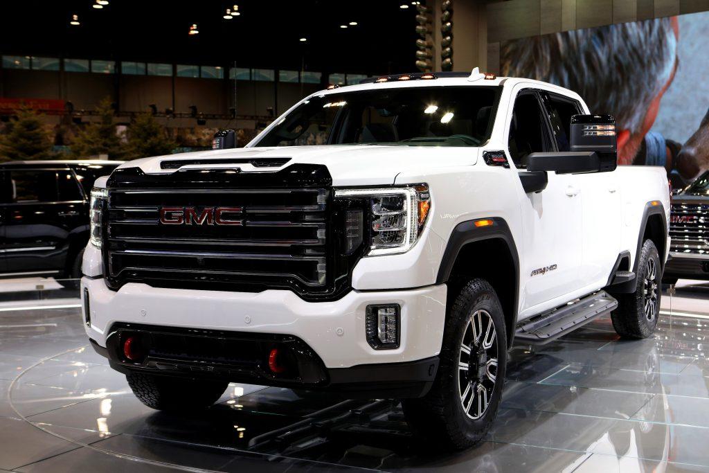 A white GMC Sierra pickup truck on display