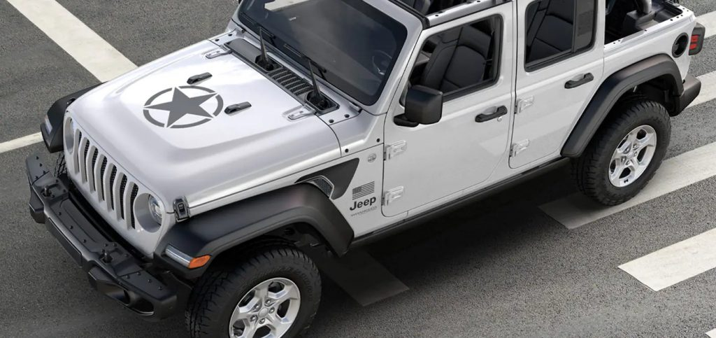 A white Jeep Wrangler with a black star on the hood