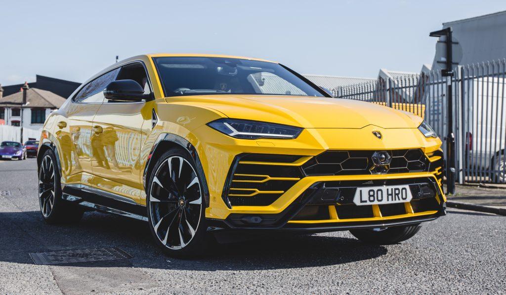 A yellow Lamborghini Urus SUV